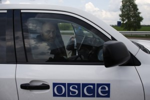 OSCE observer Axel Schneider sits in a car on a road 30 km (19 miles) from Donetsk after being freed by pro-Russian separatists